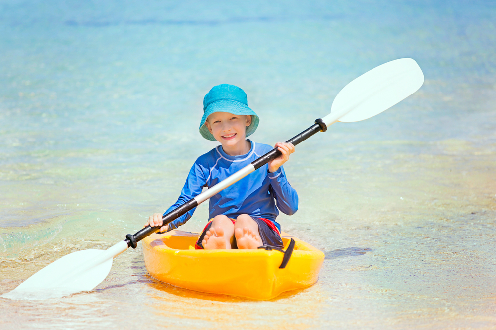 School Holiday Activities for Kids Near Cairns – You Can't Beat Fitzroy Island Give Sea Kayaking And or Stand Up Paddle Boarding (SUP) A Shot